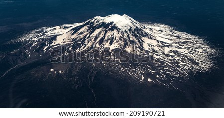 Panorama view of mount rainier from aeroplane - stock photo