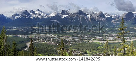 Panorama view of Mountains and the town of Canmore, Alberta, Canada  Picture taken on the hike up Mount Lady MacDonald. - stock photo