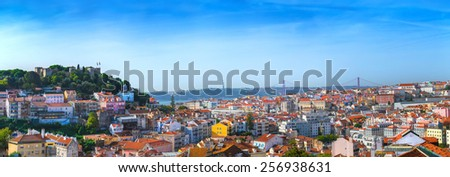 Panorama view of old town Lisbon and Sao Jorge Castle, the capital and the largest city of Portugal - stock photo