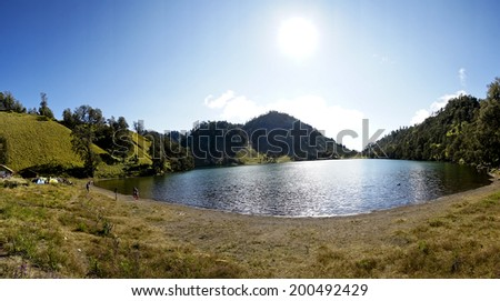 Panorama View of Ranu Kumbulo, 1st camp site at Semeru Volcano Mountain, East Java, Indonesia. Semeru Mountain also known as Mahameru Mountain in Indonesia means the great mountain.  - stock photo