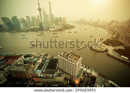 Panorama view of Shanghai city scape in fog at sunset time. Aerial view - stock photo