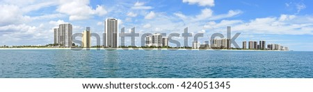 Panorama view of Singer Island, Florida from the Ocean Mall shopping center, north with upscale condominiums, both new and old, as seen from the Atlantic Ocean. - stock photo