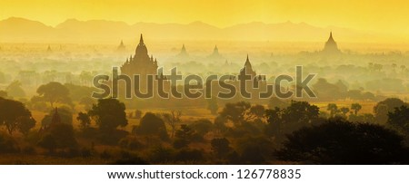Panorama View of Sunrise over temples of Bagan in Myanmar - stock photo
