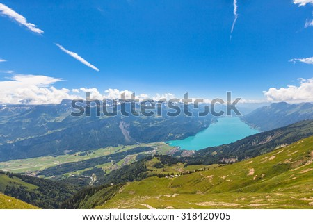 Panorama view of the Brienz lake and the alps from the mountains on hiking trail on Bernese Oberland near the famous tourism region of Interlaken, Jungfrau region, Switzerland. - stock photo
