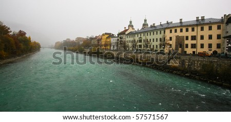 Panorama view of the Innsbruck city over the river Inn - stock photo