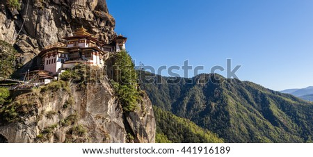 Panorama view of Tiger's Nest monastery situated dangerously at the mountain cliff's edge. - stock photo