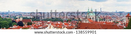Panorama view of tile roofs in a historical part of Prague - stock photo