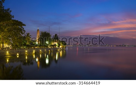 Panorama view of Tran Quoc pagoda at West Lake in sunset. Tran Quoc is the oldest pagoda in Vietnam