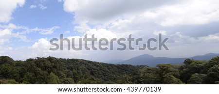 Panorama view of tropical forest mountains - stock photo