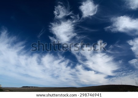Panorama view on mountain and dark blue sky with white clouds - stock photo