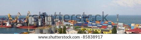 Panorama view on the port with loading cargo ship - stock photo
