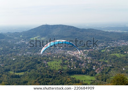 Panorama view with paraglider from summit Merkur to Baden-Baden, Germany - stock photo
