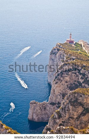Panorama with Capri lighthouse and boats during a sunny day - stock photo