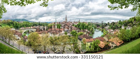 Panorama with Church, bridge and houses with tiled rooftops, Bern, Switzerland. - stock photo