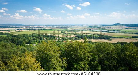 Panorama with forest and open fields - stock photo