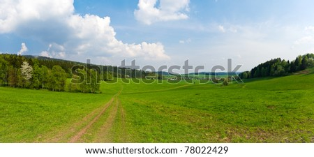 Panorama with fresh green meadows - stock photo