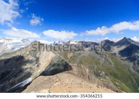 Panorama with lake Eissee, mountain Weissspitze and glacier Grossvenediger in the Hohe Tauern Alps, Austria - stock photo