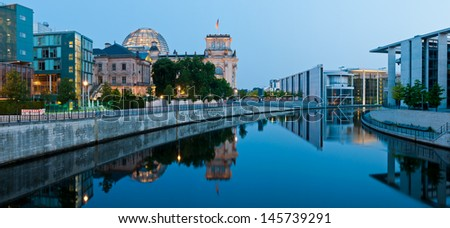panorama with reichstagufer and spree river in berlin, germany at night - stock photo