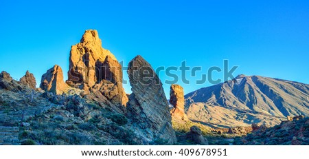Panorama with Teide mountain and Garcia stone at sunset, in spring season - stock photo