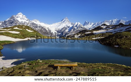 Panorama with Wetterhorn, Schreckhorn, and Finsteraarhorn peaks as seen from the Bachalpsee lake in the Swiss Alps. - stock photo