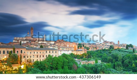Panoramatic view of Siena at magical sunset, Italy - stock photo