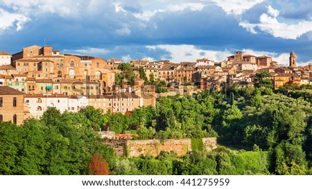 Panoramatic view of Siena with magical light, Italy - stock photo