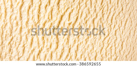 Panoramic Abstract Texture Background - Close Up of Ridges in Surface of Creamy, Sweet and Cold Vanilla Bourbon Frozen Dairy Ice Cream Dessert - stock photo