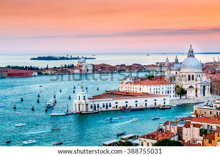 Panoramic aerial cityscape of Venice and Grand Canal with Santa Maria della Salute church at sunset, view from Campanile di San Marco to Venetian Lagoon, Italy - stock photo