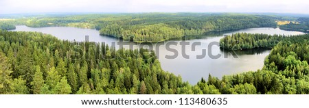 Panoramic aerial view of a lake among the forests of Finland - stock photo