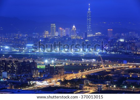 Panoramic aerial view of busy Taipei City ~Taipei 101, Keelung river, Dazhi Bridge, Songshan Airport and downtown at blue dusk ~ A romantic evening in Taipei Taiwan with beautiful blue mood in the sky - stock photo