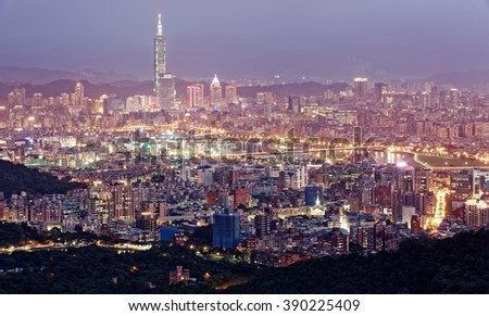 Panoramic aerial view of crowded Taipei City with Taipei 101 Tower in XinYi Commercial District, Keelung River and downtown area at hazy & moody dusk ~ Taipei City skyline in gloomy evening twilight