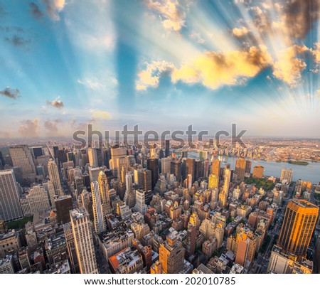 Panoramic aerial view of Manhattan at dusk.