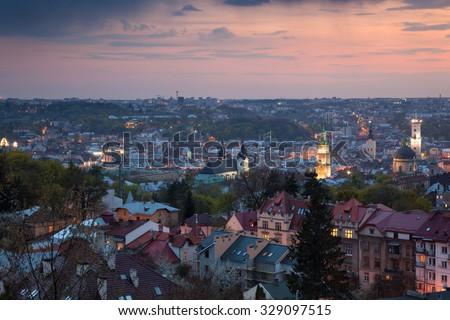 Panoramic Aerial view of old town at sundown. Lviv, Ukraine, Europe - stock photo
