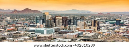 Panoramic aerial view of the Phoenix, Arizona skyline against the day's blue sky. - stock photo