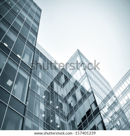 Panoramic and perspective wide angle view to steel blue background of glass high rise building skyscrapers in modern futuristic downtown at night Business concept of successful industrial architecture - stock photo