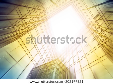 Panoramic and perspective wide angle view to steel light blue sky texture of glass high rise tall building skyscraper commercial modern city of future Business concept of success industry architecture - stock photo