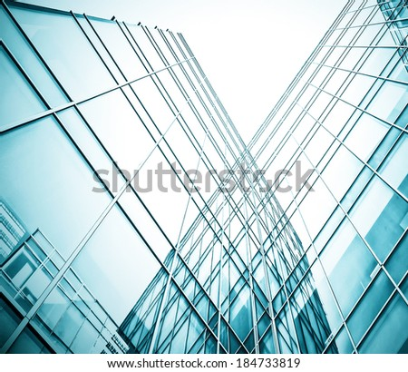 Panoramic and prospective wide angle view to steel light blue background of glass high rise building skyscraper, commercial modern city of future Business concept of successful industrial architecture