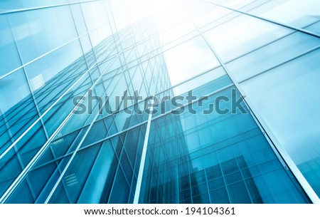 Panoramic and prospective wide angle view to steel light blue background of glass high rise building skyscraper commercial modern city of future. Business concept of successful industrial architecture - stock photo