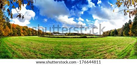 Panoramic autumn landscape with abandoned hippodrome  - stock photo