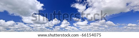 Panoramic background of blue sky with white cumulus clouds - stock photo
