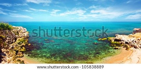Panoramic blue lagoon, clear waters of Mediterranean sea, romantic island with peaceful sandy beach, bird eye panorama of coastal bay, beautiful seascape, ocean landscape, summer vacation and travel - stock photo