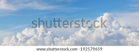 panoramic blue sky with beautiful cumulus clouds - stock photo