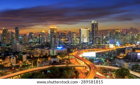 Panoramic building modern business district of Bangkok. S-shaped expressway in the foreground at twilight. - stock photo