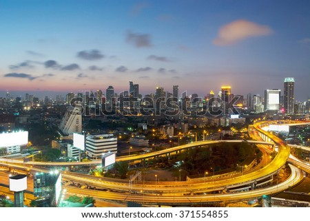 Panoramic building modern business district of Bangkok. S-shaped expressway in the foreground at twilight.