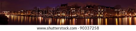 Panoramic city scenic with the Thiny Bridge at night in Amsterdam the Netherlands - stock photo
