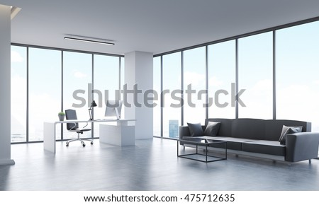 Panoramic city view from office with long gray sofa, white computer table and black leather armchair. Concept of office life. 3d rendering.