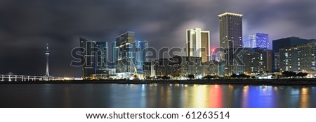 Panoramic cityscape in night with skyscraper and buildings and river in Macao, China. - stock photo