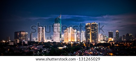 Panoramic cityscape of Indonesia capital city Jakarta at night - stock photo