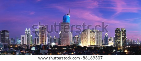 Panoramic cityscape of Indonesia capital city Jakarta at sunset - stock photo