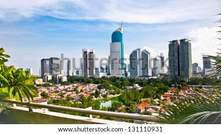 Panoramic cityscape of Indonesia capital city Jakarta at suny day - stock photo